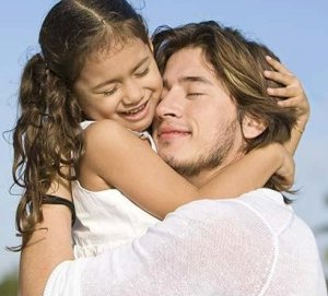 father_hugging_daughter_BLD073655