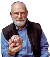 oliver-sacks-with-brain-in-hand.png