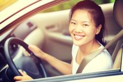 49929379-young-asian-woman-driver-driving-a-car